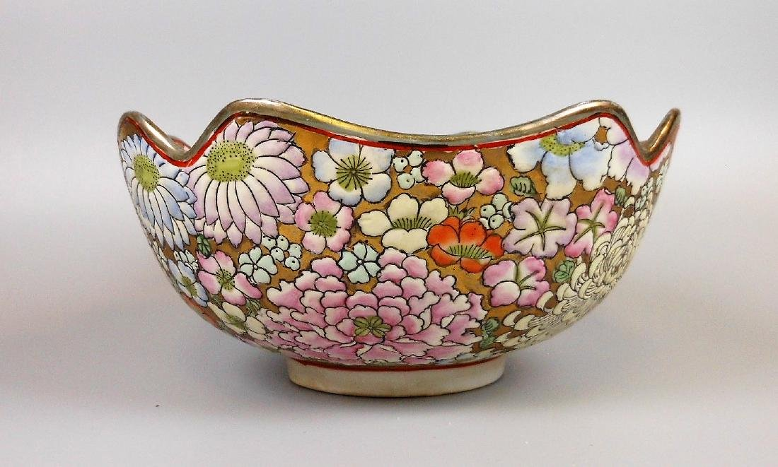 A large Japanese  porcelain famille rose bowl