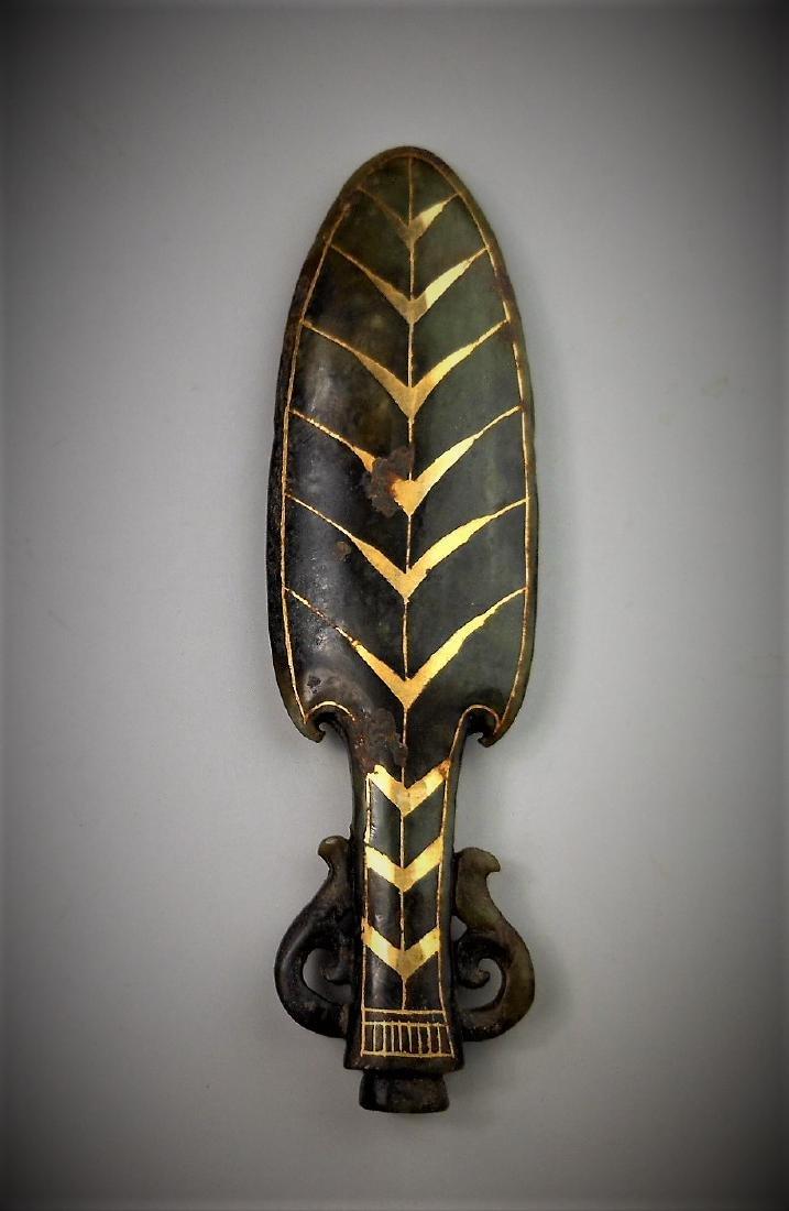 A Chinese archaic gilt jade pendant
