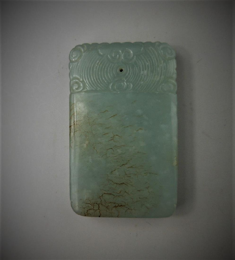 A Chinese Qing dynasty hetian celadon jade pendant