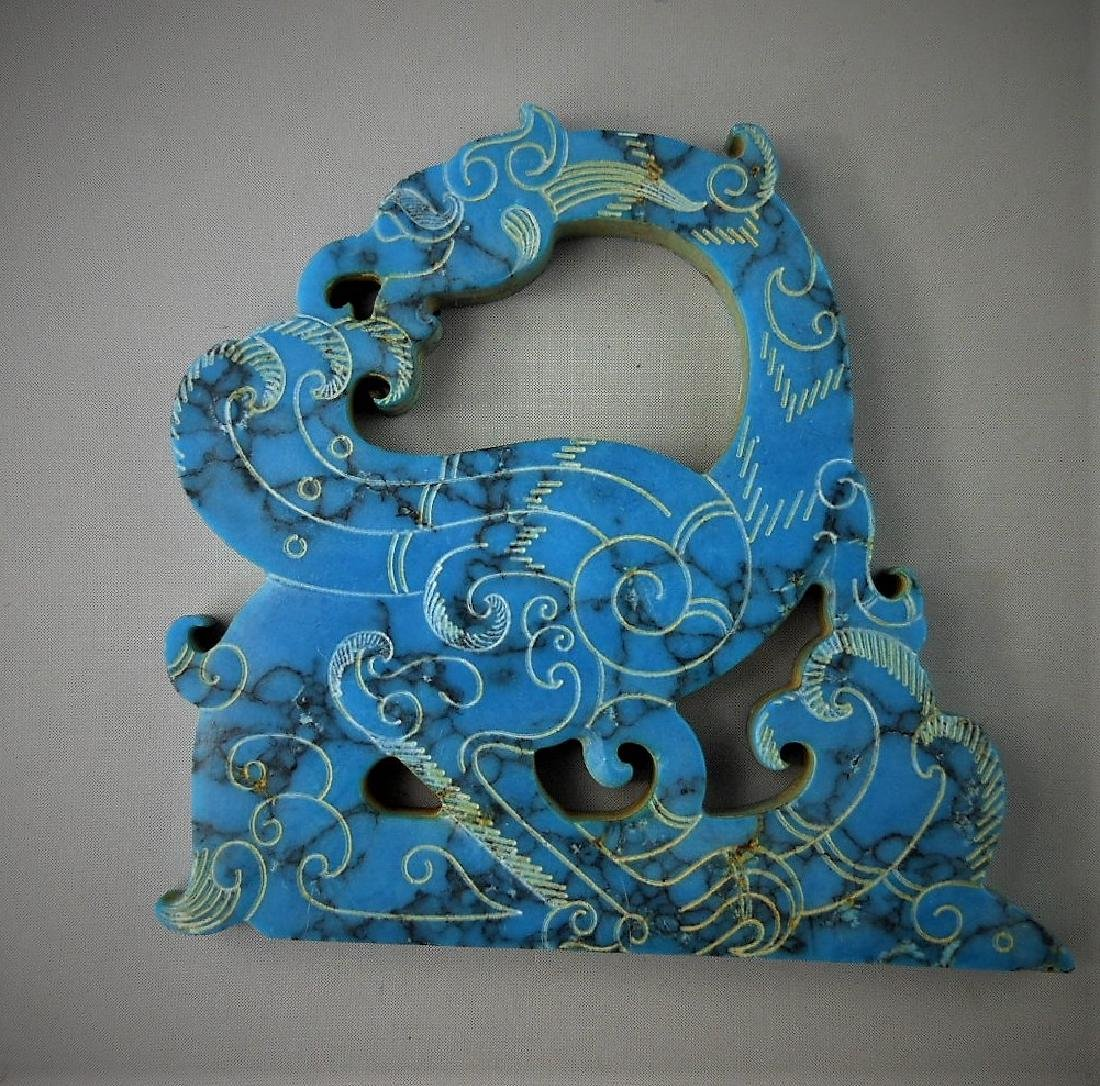 A Chinese archaic turquoise carved dragon-formed