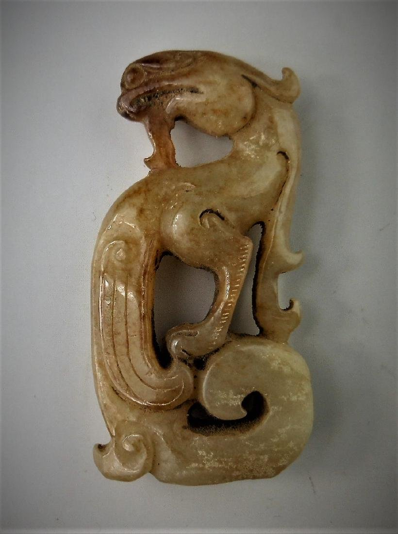 A Chinese archaic jade carved phoenix-formed pendant