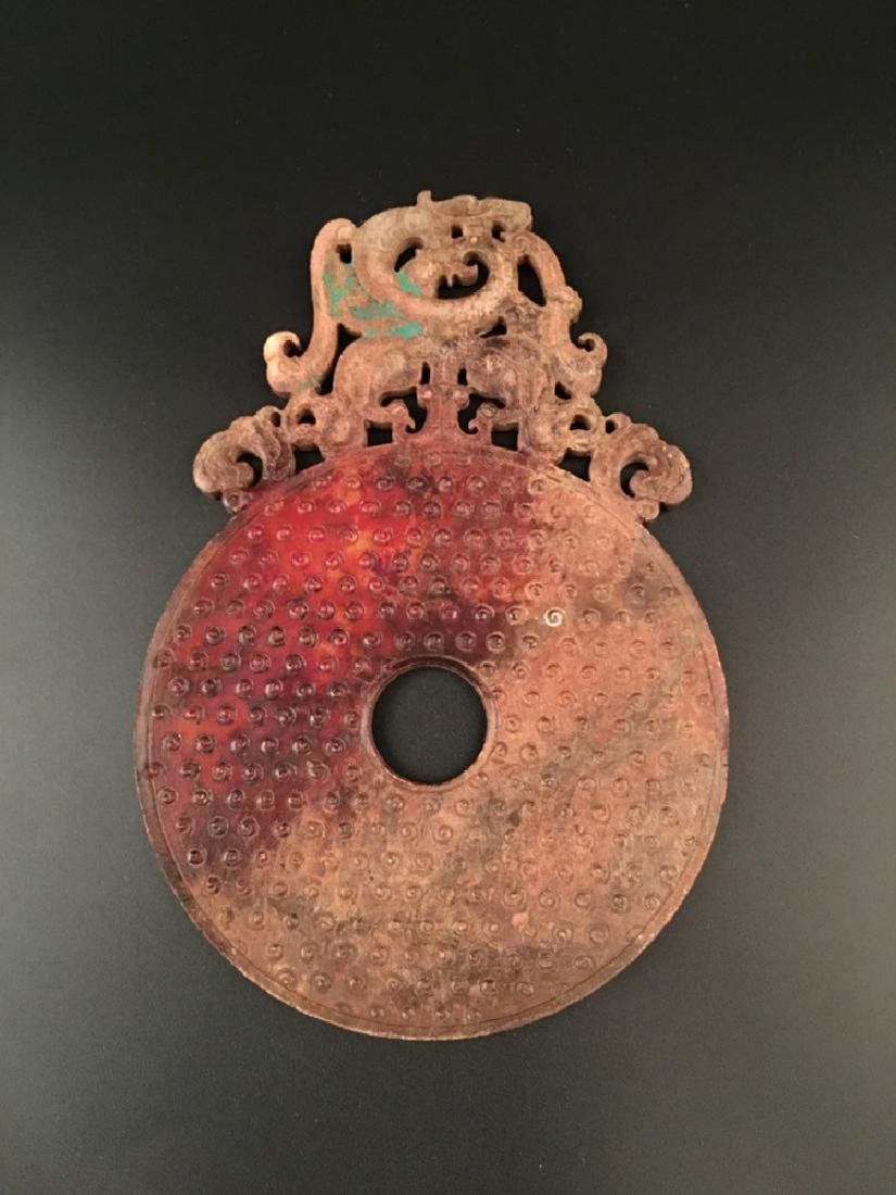 A Chinese large archaic jade carved disc