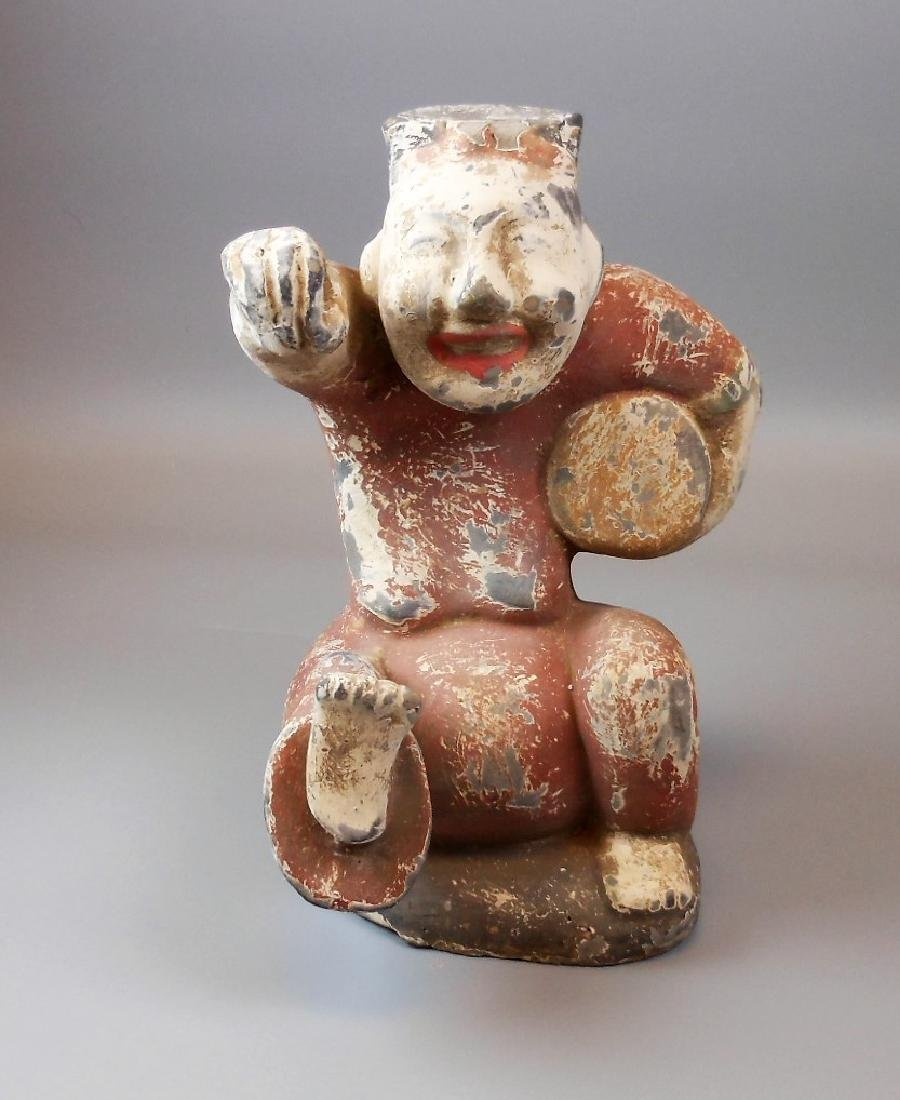 A Chinese Tang style pottery figure