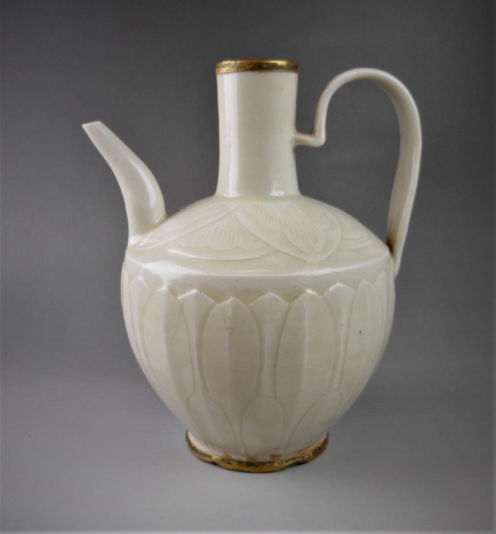 A Chinese Ding-yao white glazed porcelain wine pot