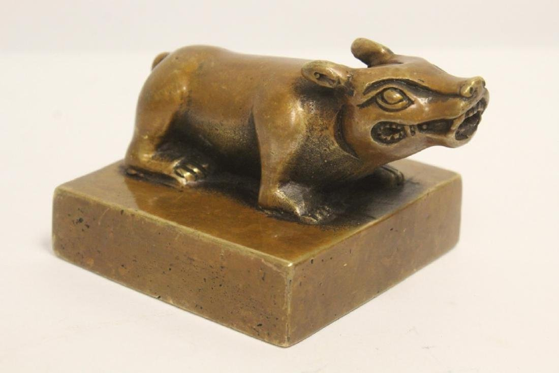 A Chinese archaic bronze seal with buffalo finial