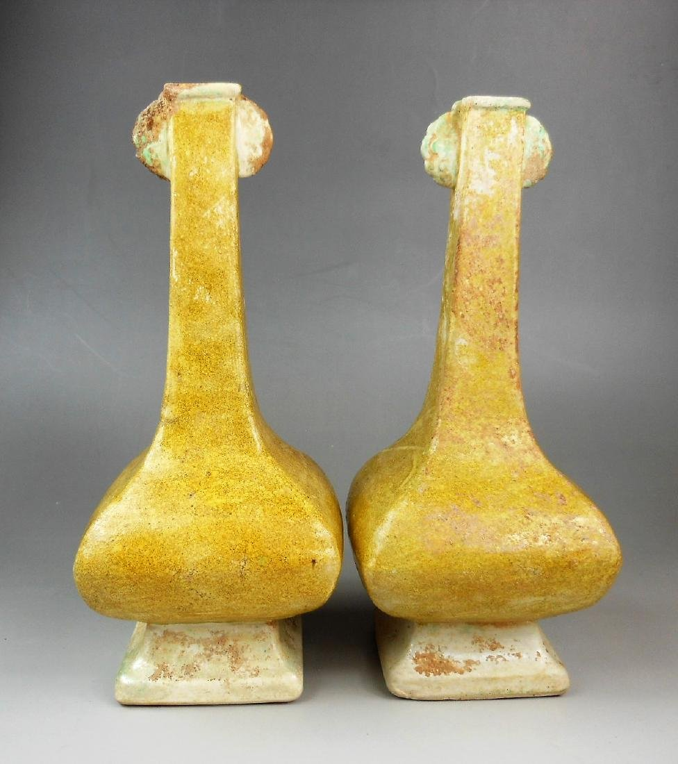 A pair of Chinese Liao/Jin period yellow glazed
