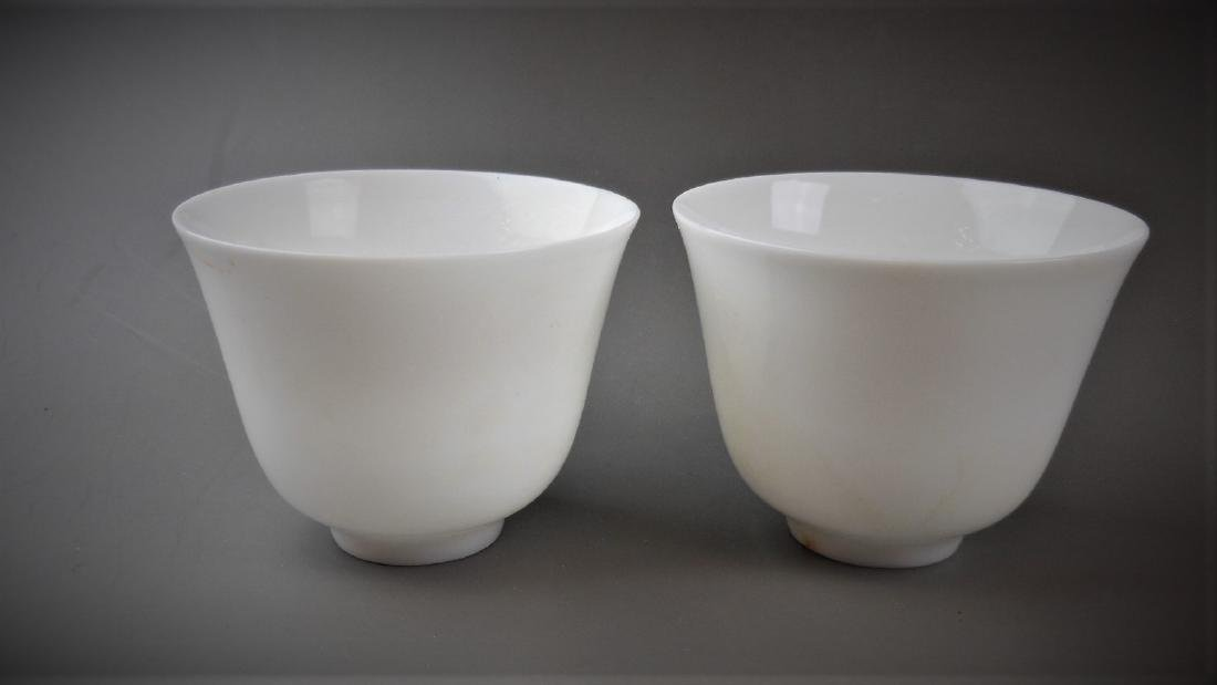 A pair of Chinese Ming dynasty white glazed porcelain