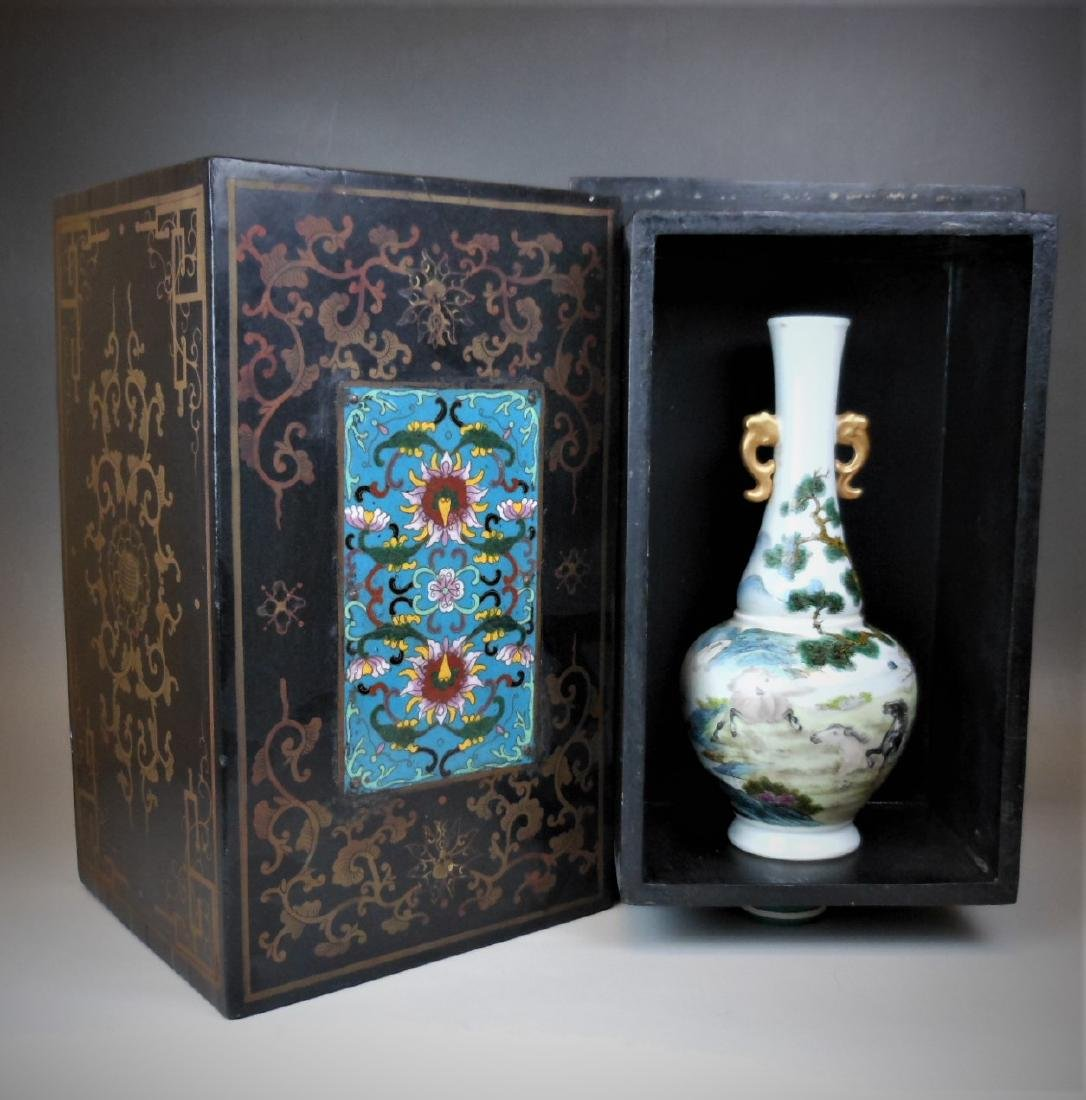 A Chinese Qing dynasty famille rose vase