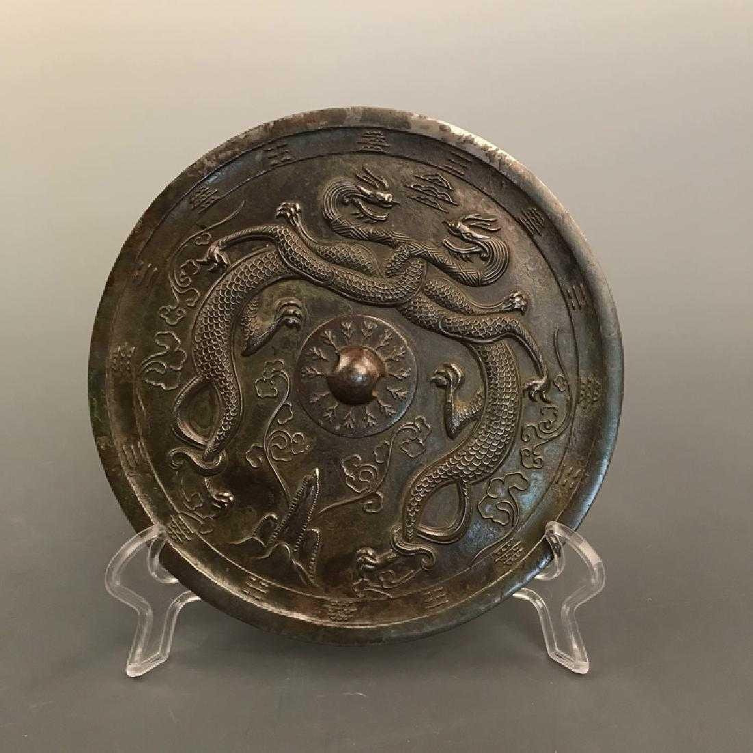 A Chinese archaic style bronze mirror