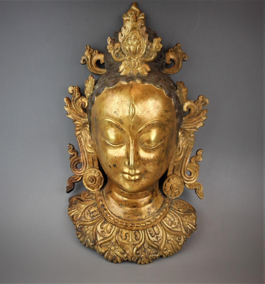 A Chinese Qing dynasty gilt bronze Buddha head