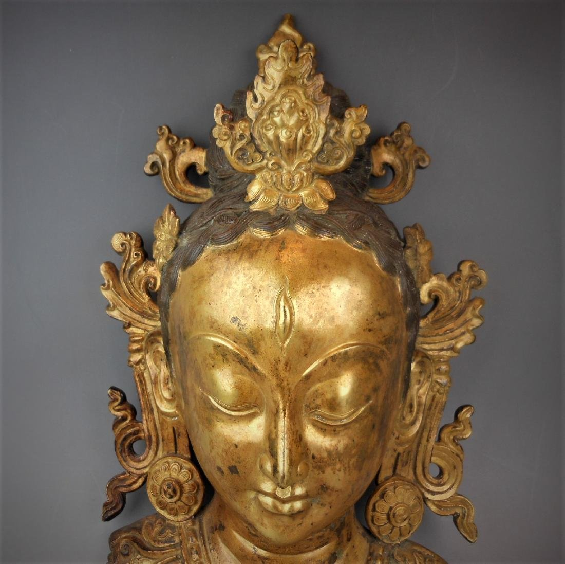 A Chinese Qing dynasty gilt bronze Buddha head - 2