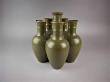 A Chinese tea glazed porcelain six tube vase