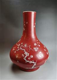 A Chinese Qing dynasty red glazed porcelain vase