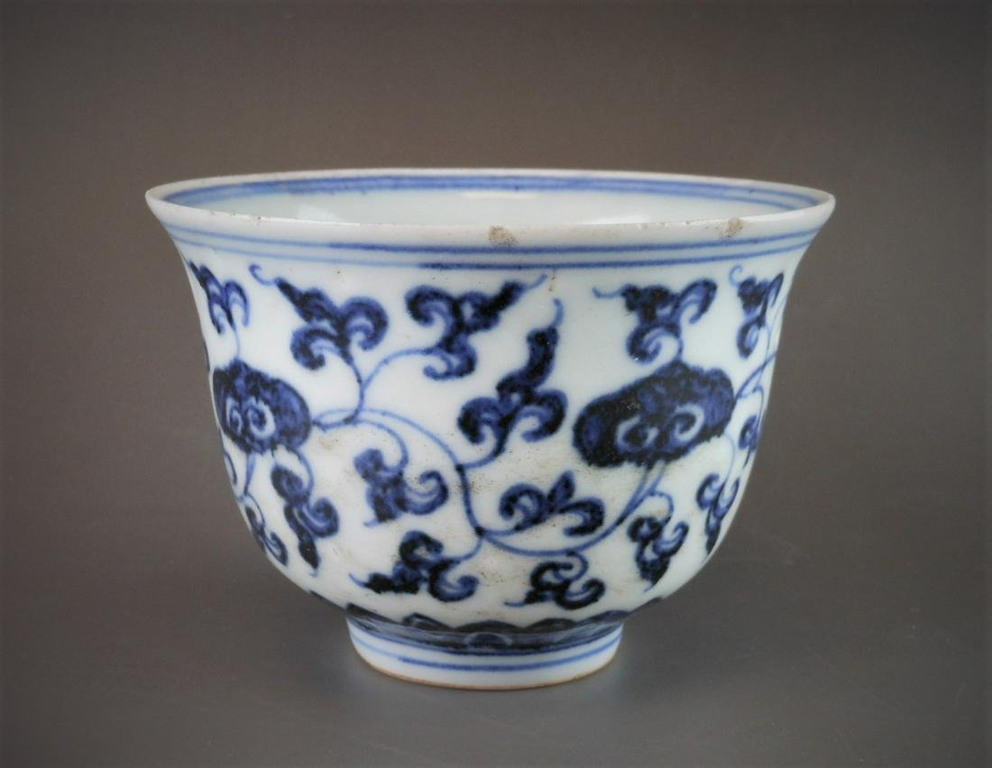 A Chinese Ming style blue and white porcelain cup
