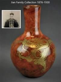 A Chinese brown glazed gilt dragon porcelain vase