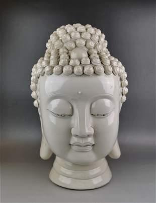 A Chinese white glazed head of Buddha