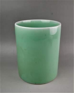 A Chinese green glazed brush holder