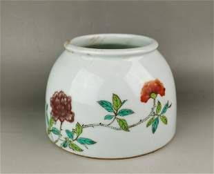 A Chinese Qing style wucai floral porcelain brush