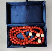 A Chinese red coral nacklace with four elephant bone
