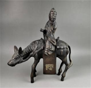 A Chinese Qing dynasty iron carved figure and horse