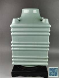 A Chinese celadon glazed porcelain five-tube and