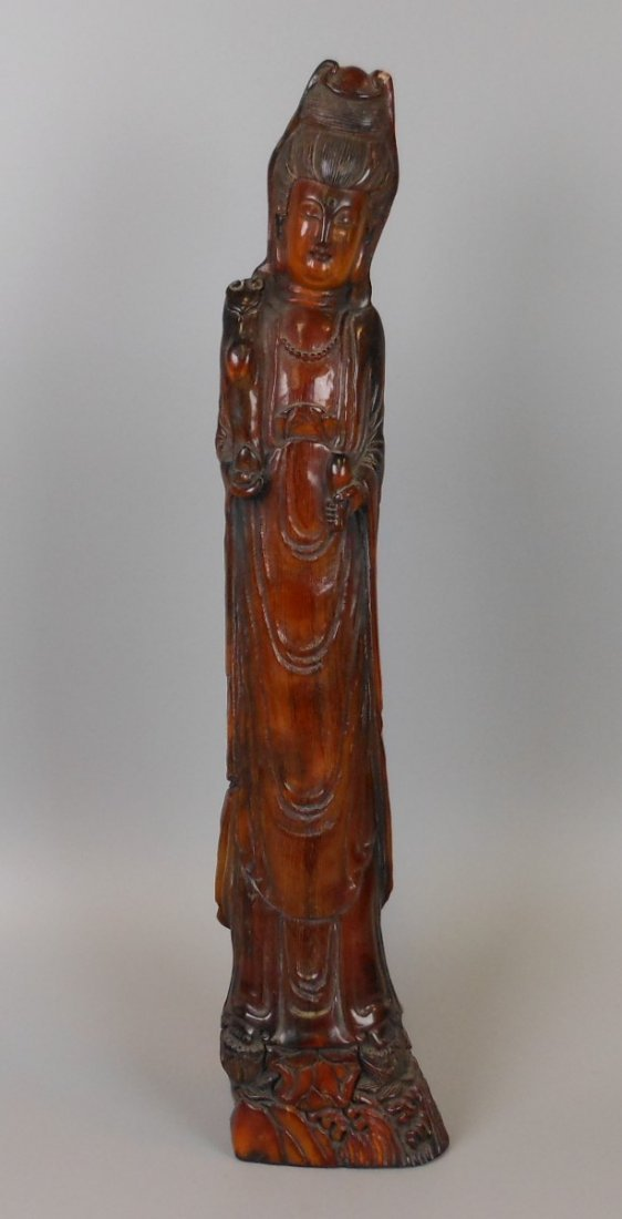A Chinese carved horn Guanyin