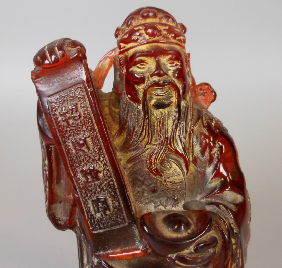 A Chinese carved amber figure - 5