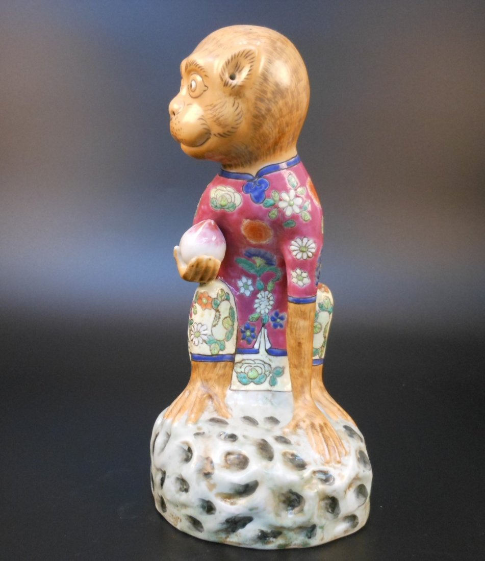 A Chinese famille rose porcelain monkey and peach