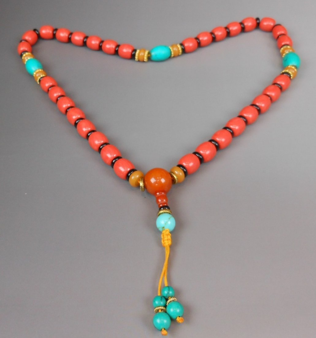 A Chinese coral bead necklace