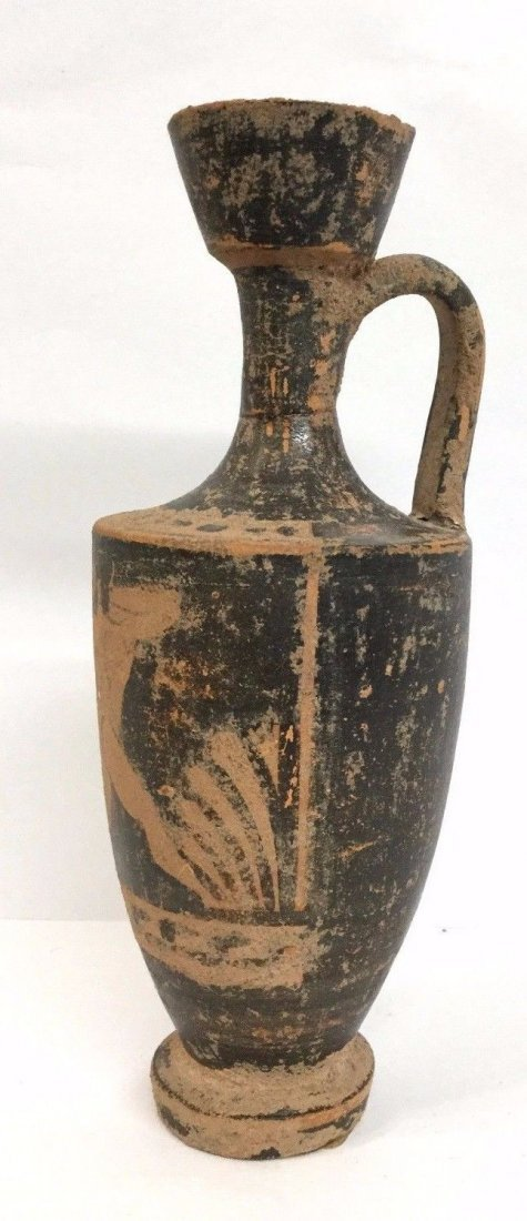 Ancient Greek black-figured lekythos . - 2