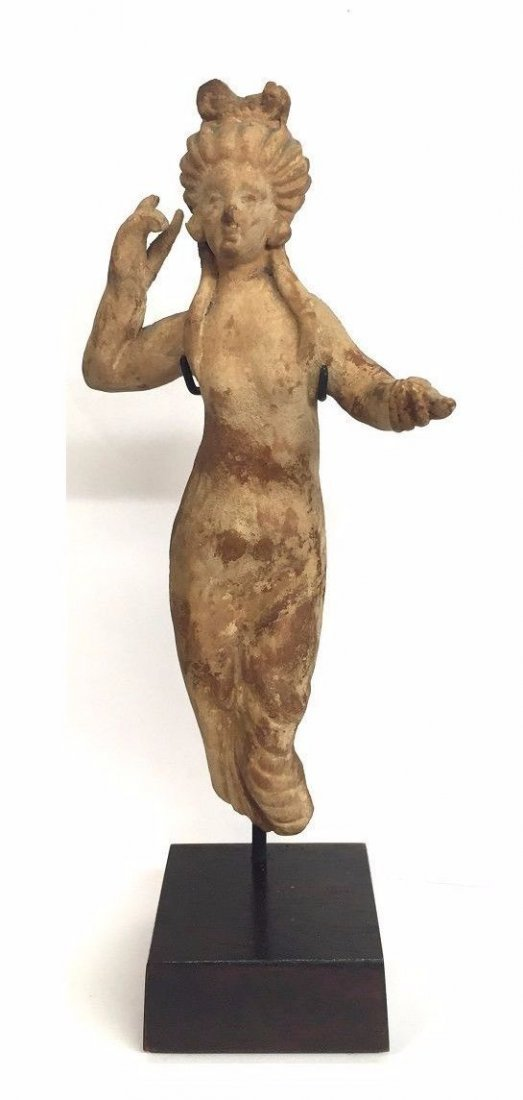 Ancient Greek Clay figurine of Aphrodite statue .