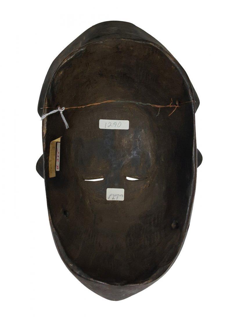 FLAT FACE WOODEN DAN MASK, CA. 1900 - 2