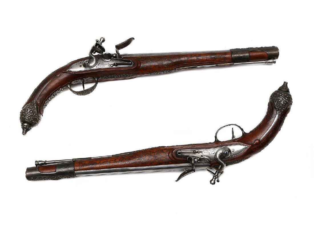 A PAIR OF FRENCH FLINTLOCK PISTOLS FOR EASTERN MARKET,