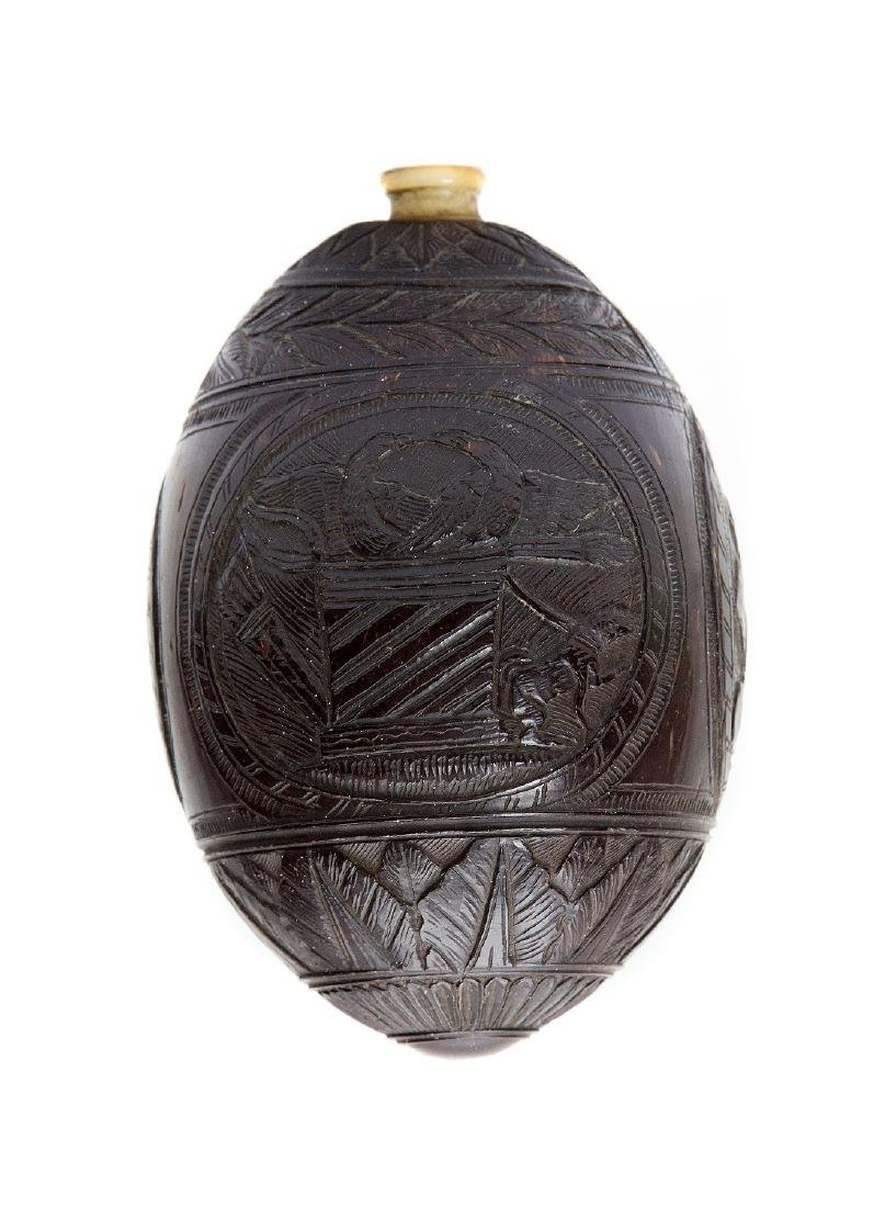 A CARVED COCO-DE-MER, W COAST OF INDIA OR CEYLON, 18TH