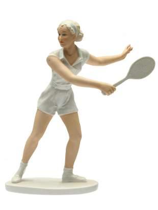 A GERMAN PORCELAIN FIGURINE OF A TENNIS PLAYER