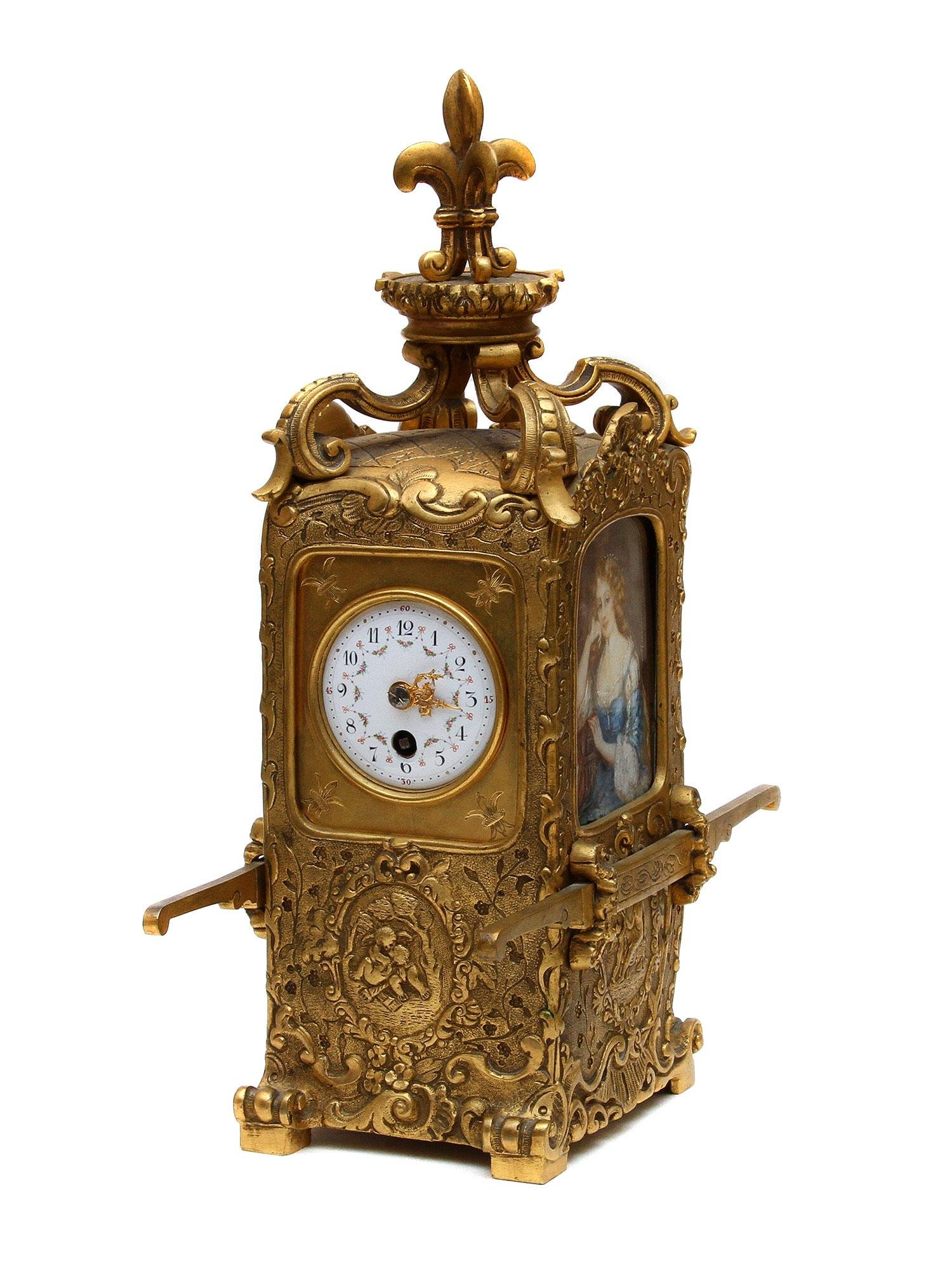A GILT FRENCH BRONZE CARRIAGE CLOCK WITH MINIATURES
