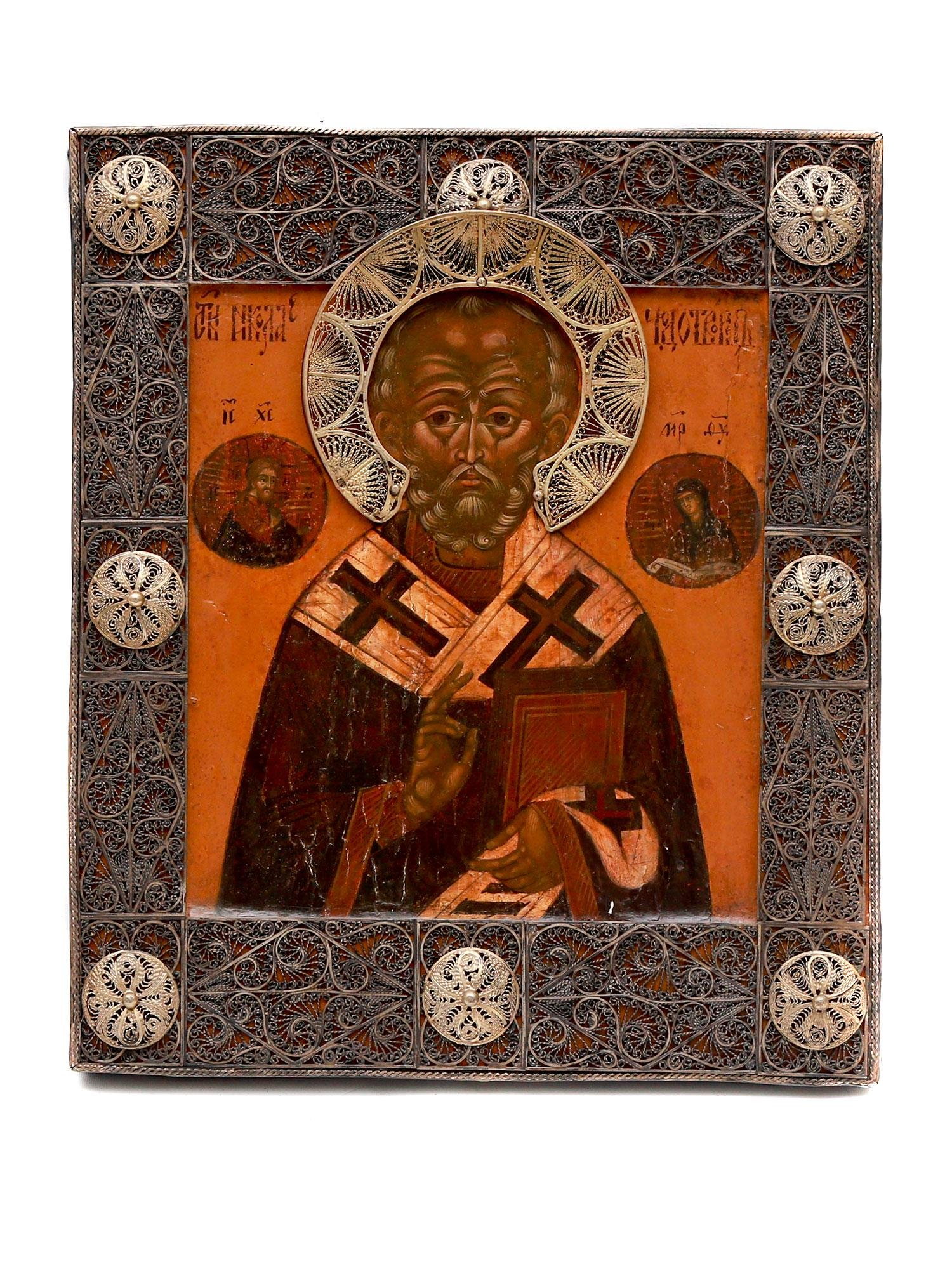 A RUSSIAN ORTHODOX ICON OF ST. NICHOLS in SILVER OKLAD