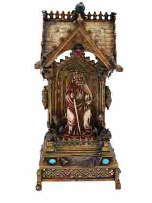 A GILTBRONZE MINIATURE THRONE WITH CARVED SAINT