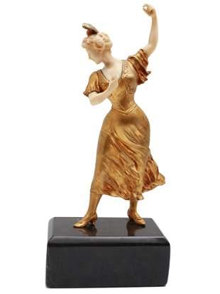 AN ART DECO GILTBRONZE DANCER FIGURINE