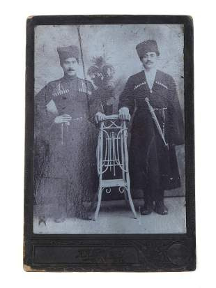 PHOTO OF TWO CAUCASIAN MEN WITH DAGGERS BAKU