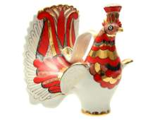 A SOVIET LENINGRAD PORCELAIN DECANTER AS A RUSTER