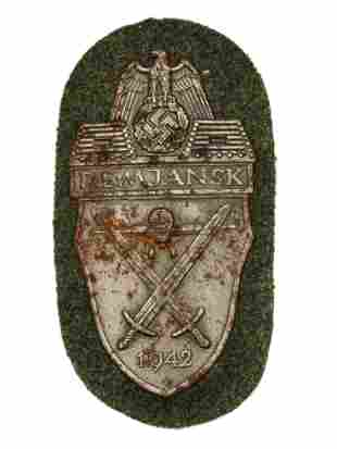 A GERMAN WWII ARMY ISSUED DEMJANSK SHIELD
