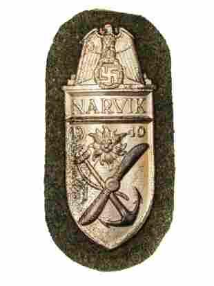 A GERMAN WW2 NARVIK SLEEVE SHIELD (HEER)