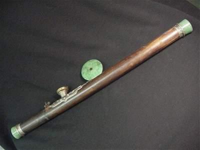 602: Bamboo and jade opium pipe.