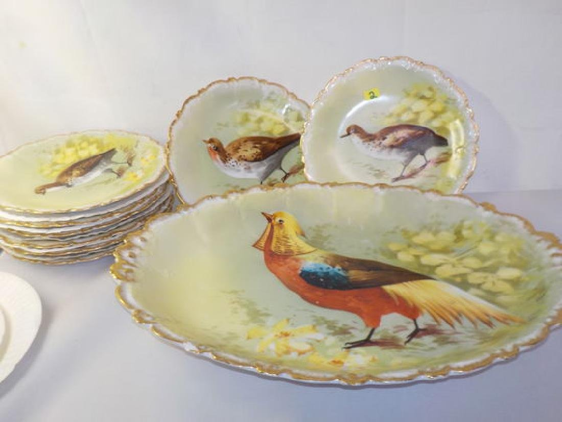 Game Service set: set of 8 plates w/ handpainted bird/