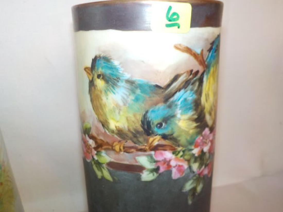 Vase w/ handpainted bluebirds sitting on a floral vine