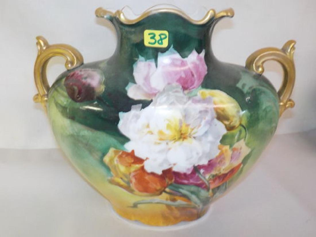 "Two handled pillow vase w/ vibrant flowers 8.5"" H x 10"""