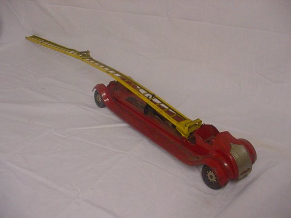 "706: Kingsbury toy Firetruck.Approx.23"" long."