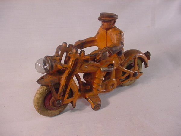 """722: Cast iron early motorcycle 6 1/2"""" long, has damage"""