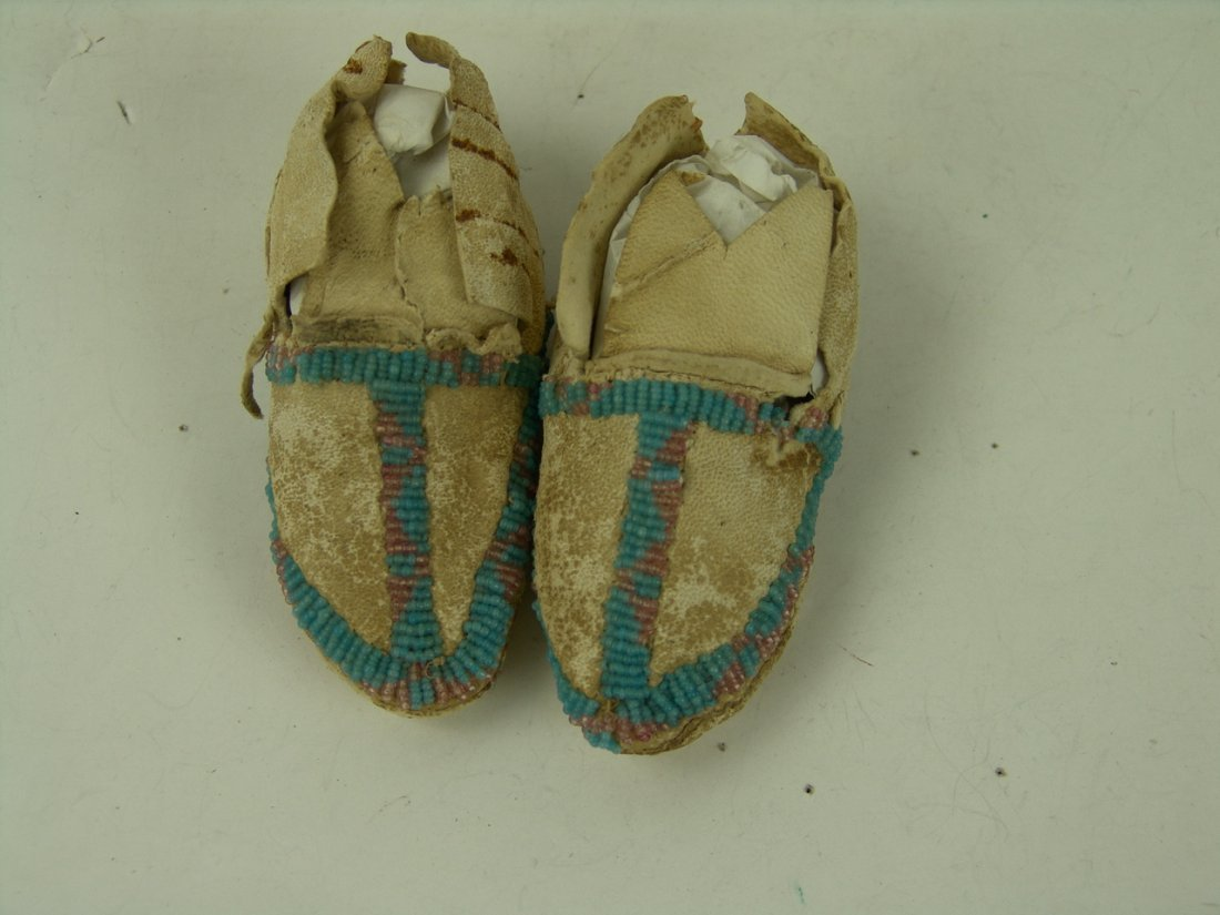 16: Crow Beaded Baby Moccasins
